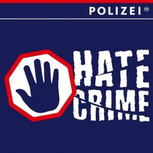 """Die Grafik zeigt ein Stoppschild mit einer Hand und ein zersprungene Schrift mit """"Hate Crime""""."""